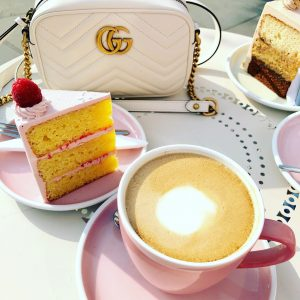 Coffee and Cake at the table at Peggy Porschen Cakes in Belgravia London