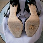 Soles of the Jimmy Choo Lumiere Patent Black Shoes