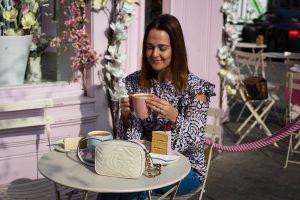 Drinking coffee outside Peggy Porschen in London