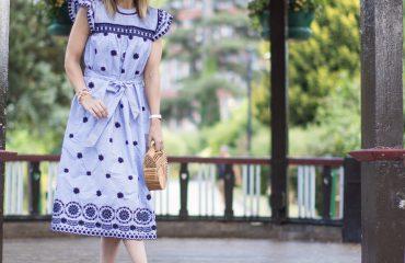 Rebecca Denise wearing blue midi dress