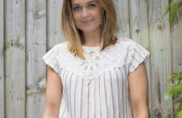Rebecca Denise wearing neutral stripe tee